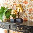 Side table with flowers and interior decoration — Stock Photo