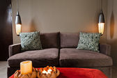 Brown two seated sofa dark ambience — Stock Photo