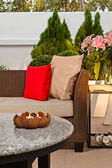 Outdoor patio seating are with nice Rattan sofa — Stock Photo
