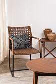 Brown rattan Chair in interior setting — Stock Photo