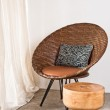Brown rattan Chair in interior setting — Stock Photo #22356313