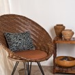 Brown rattan Chair in interior setting — Stock Photo #22356351