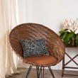 Brown rattan Chair in interior setting — Stock Photo #22356401