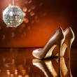 Stock Photo: Beautiful brown stilettos on the dance floor
