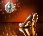 Beautiful brown stilettos on the dance floor — Stock Photo