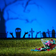 Zombie hands and graveyard — Stock Photo #26708587