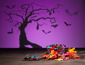 Halloween tree bats and sweets — Stock fotografie