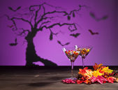 Halloween landscape with sweets — Stock Photo