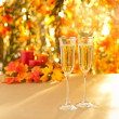 Champagne glasses for reception in front of autumn background — Zdjęcie stockowe #26967321