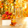 Champagne glasses for reception in front of autumn background — Stock Photo