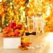 Champagne glasses with conceptual heterosexual decoration — Stock Photo