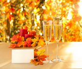 Champagne glasses for reception in front of autumn background — 图库照片