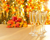 Champagne glasses for reception in front of autumn background — Photo
