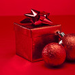 Red bauble and Christmas present — Stock Photo