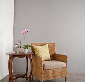 Rattan sofa chair in a lounge setting — Stock Photo