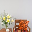 Colorful upholstered chair with side table — Stock Photo #41552203