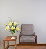 Beige upholstered chair with side table — Foto de Stock