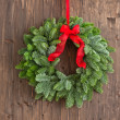 Advent wreath over brown wooden plank — Stock Photo #42042549