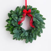 Advent wreath over a bright wall — Stock Photo