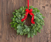 Advent wreath over a brown wooden plank — Stock Photo