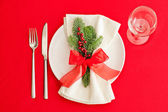 Christmas Dinner table, place setting in red — Stock Photo