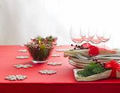 Red Christmas dinner table setup  — Stock Photo