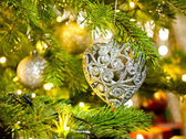 Bauble in a Christmas tree  — Photo