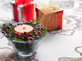 Present in winter decoration — Stock Photo