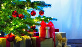 Christmas tree decorated with presents — Stock Photo
