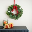 Advent wreath over side board with present — Stock Photo #43992103