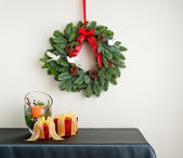 Advent wreath over side board with present — Stock Photo