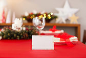 Red Christmas dinner table setup with name card — Stock Photo