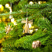 Straw Ornament in a real Christmas tree  — Stock Photo