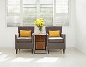 Grey sofa armchair in simple setting — Stock Photo