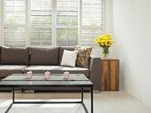 Grey sofa in simple setting — Stock Photo