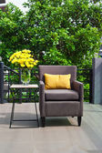 Outdoor patio seating are with nice Rattan sofa at sunset — Stock Photo
