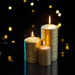 Three golden Candles — Stock Photo #48261623