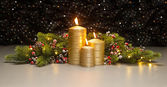 Three golden Candles — Stock Photo