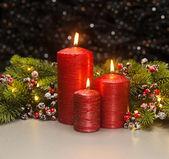 Três velas vermelhas — Fotografia Stock