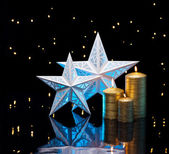 Backlit stars in blue with golden candles — Stock Photo