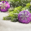 Christmas tree bauble with Christmas tree branches — Stock Photo #48671229