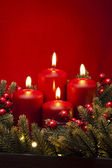 4th Advent red candle flower arrangement — Stock Photo