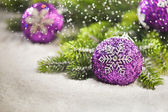 Christmas tree bauble with Christmas tree branches — Stock Photo