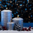 Three Silver Candles in snow — Stock Photo #48938625