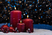 Three Red Candles in snow  — Stock Photo