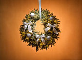 Advent wreath over beige background — Stock Photo