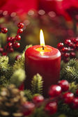 Advent wreath over red background — Stockfoto