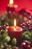Advent wreath over red background — Stock Photo