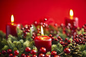 Advent wreath over red background — Stock fotografie