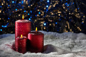 Candles in snow — Стоковое фото